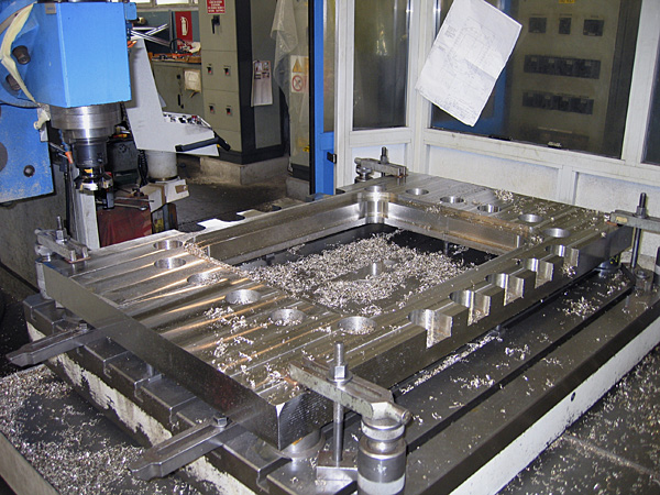Slide valve, orifice plate machining