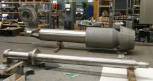 Plug valves: stem tube ready for assembling and stem (foreground)